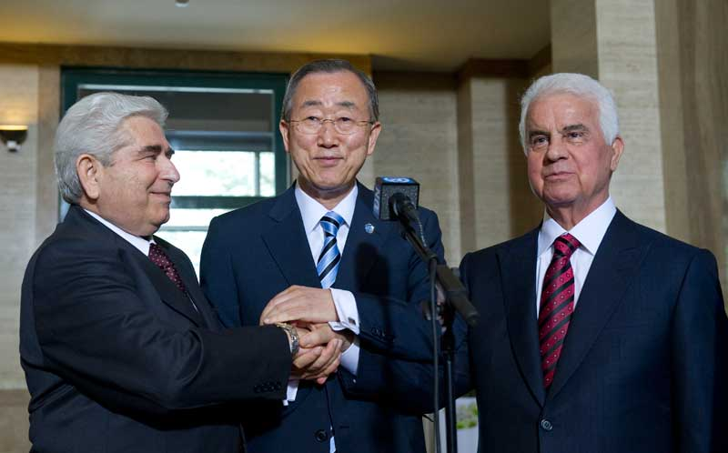 EROGLU and CHRISTOPHIAS HOLDING HAND WITH BAN KI MOON